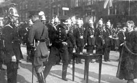 Prince of Wales presenting fire service medals on the occasion of his visit to Chester