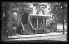 View: c11605 USA: View of cobbled street- wooden houses with stairs and porches